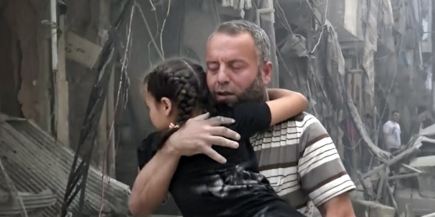 In this image made from video and posted online from Validated UGC, a man carries a child after airstrikes hit Aleppo, Syria, Thursday, April 28, 2016. A Syrian monitoring group and a first-responders team say new airstrikes on the rebel-held part of the contested city of Aleppo have killed over a dozen people and brought down at least one residential building. The new violence on Thursday brings the death toll in the past 24-hours in the deeply divided city to at least 61 killed. (Validated UGC