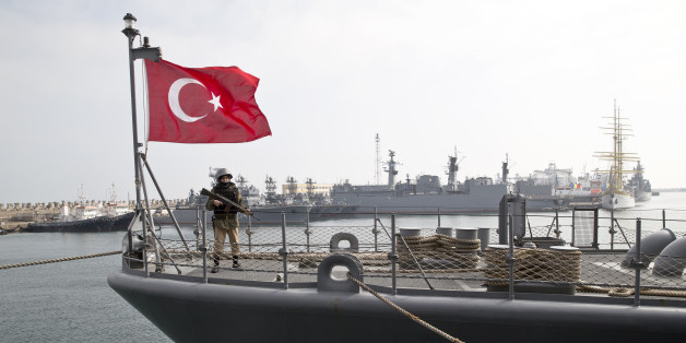 A Turkish marine serviceman stands on the deck of a Turkish navy TCG Turgutreis vessel in the Black Sea port of Constanta, Romania, Sunday, March 15, 2015. The ship will take part in NATO sea military exercises in the Black Sea region involving ships USS Vicksburg, as well as a German auxiliary ship and frigates from Canada, Turkey, Italy and Romania.(AP Photo/Vadim Ghirda)