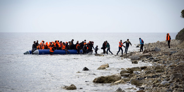 MYTELENE, GREECE - MARCH 09:  Syrian refugees arrive on an inflatable boat with other refugee after crossing the sea from Turkey to Lesbos, some 5 kilometres south of the capital of the Island, Mytelene on March 9, 2016 in Mytelene, Greece. Six inflatable boats reached during the night the beaches of Lesbos, as well as another 3 during the morning hours. The Greek Coast Guard picked up another dinghie and brought the refugees to the port of Mytelene. Joined Forces of the Standing NATO (North Atlantic Treaty Organisation) Maritime Group 2, including German Navy supply vessel 'Bonn' have arrived at the coast of the greek Island of Lesbos today in order to patrol between the coast of Turkey and Greece. Turkey has announced today to take back illegal migrants from Syria and to exchange those with legal migrants.  (Photo by Alexander Koerner/Getty Images)