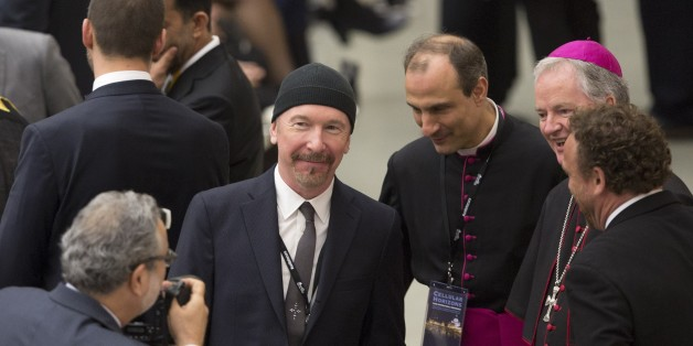 VATICAN CITY, VATICAN - APRIL 29:  U2 rock band's guitarist The Edge (C) pose for a photo with some bishops before the Pope Francis receives in audience the participants at the international conference promoted by the Pontifical Council for Culture on the progress of regenerative medicine and its cultural impact, at Paul VI Audience Hall in the Vatican City, Vatican on April 29, 2016. (Photo by Riccardo De Luca/Anadolu Agency/Getty Images)