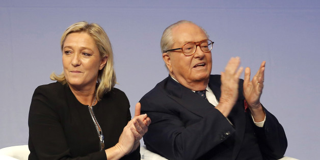 FILE - In this Saturday Nov. 29, 2014 file photo, French far-right Front National leader Marine Le Pen and her father Jean-Marie Le Pen applaud in Lyon, central France. A French court has reinstated Thursday July 2, 2015 Jean-Marie Le Pen as a member of the far right National Front party he founded decades ago, sending a biting blow to his daughter and party president Marine Le Pen, who had suspended him after a series of controversial and anti-Semitic statements. (AP Photo/Laurent Cipriani, File)