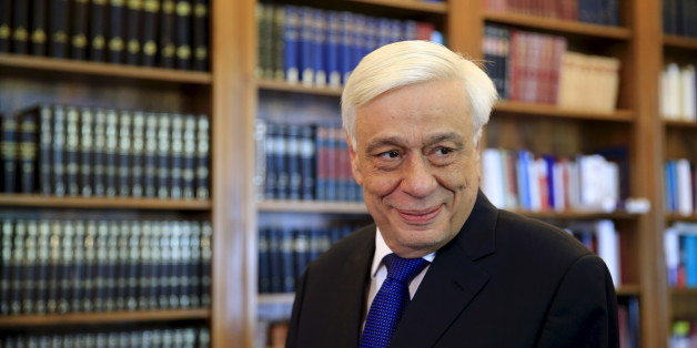 Greek President Prokopis Pavlopoulos looks on before a meeting with Popular Unity far-left leader Panagiotis Lafazanis (unseen) at the Presidential Palace in Athens, GreeceAugust 27, 2015. Greece's far-left leader on Thursday formally gave up a bid to form a coalition government, allowing the country's president to finally set a date for early elections after a week of fruitless political wrangling. REUTERS/Alkis Konstantinidis