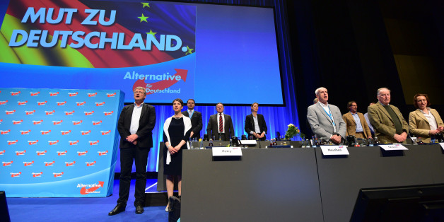 STUTTGART, GERMANY - MAY 01:  Frauke Petry (2-L), head of the Alternative fuer Deutschland (AfD) political party, and the party board sing the German national anthem at the end of the party's federal congress on May 01, 2016 in Stuttgart, Germany. A server of the party had been hacked by a left political group and the addresses of AfD members has been published. The AfD, a relative newcomer to the German political landscape, has emerged from Euro-sceptic conservatism towards a more right-wing le