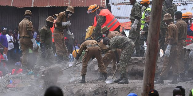 Rescue workers remove debris from the rubble of the six-storey building that collapsed killing 23 people in Nairobi's suburb of Huruma, on May 3, 2016.Kenyan rescuers pulled an 18-month-old toddler alive from the rubble of a six-storey building on May 3, four days after the block collapsed killing 23 people, police said. Located in the poor, tightly-packed Huruma neighbourhood, the building had been slated for demolition after being declared structurally unsound. But an evacuation order for the