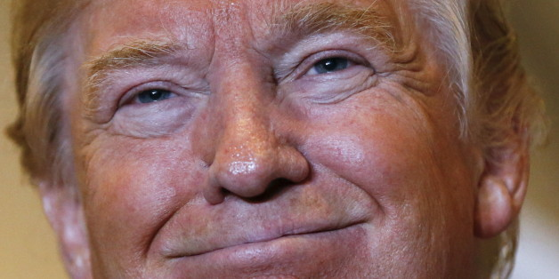 U.S. Republican presidential candidate Donald Trump smiles during a news conference to reveal his tax policy at Trump Tower in Manhattan, New York September 28, 2015.  REUTERS/Shannon Stapleton