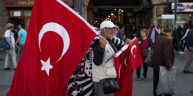 ISTANBUL, TURKEY - MAY 03:  A man sells Turkish flags on the street outside the Eminonu Mosque on May 3, 2016 in Istanbul Turkey. The European Commission is expected to recommend granting Turks with visa free travel in Europe's Schengen area, as part of the EU-Turkey migrant deal on Wednesday. EU member states and the European Parliament are set to vote on the visa deal in June, which could see visa free travel granted to Turkish citizens as early as the end of June.  (Photo by Chris McGrath/Getty Images)