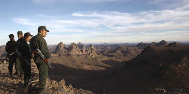 An Algerian Gendarme looks down from the top of the Askrem Mountain near Tamanrasset,  some 2,000 km (1,243 miles) south of the Algerian capital Algiers, December 13, 2013. Picture taken December 13, 2013.  REUTERS/Ramzi Boudina (ALGERIA - Tags: MILITARY ENVIRONMENT)