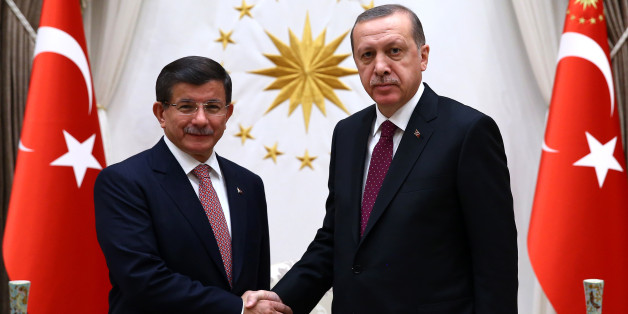 Turkey's Prime Minister Ahmet Davutoglu  left, and President Recep Tayyip Erdogan shake hands before a meeting in Ankara, Turkey, Tuesday, Nov. 17, 2015. Erdogan has re-appointed Davutoglu to form a new government after his party's victory in elections on Nov.1.(Presidential Press Service/Pool Photo via AP)