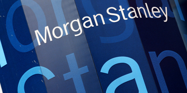 The corporate logo of financial firm Morgan Stanley is pictured on the company's world headquarters in the Manhattan borough of New York City, January 20, 2015.  Wall Street investment bank Morgan Stanley said it would pay a smaller portion of revenue in bonuses to its bankers and traders this year even in a better revenue environment. The bank reported a drop in fourth-quarter adjusted earnings, missing estimates, as it deferred fewer bonus payouts and unexpected market swings hit its division that trades bonds, currencies and commodities.   REUTERS/Mike Segar (UNITED STATES - Tags: BUSINESS LOGO)