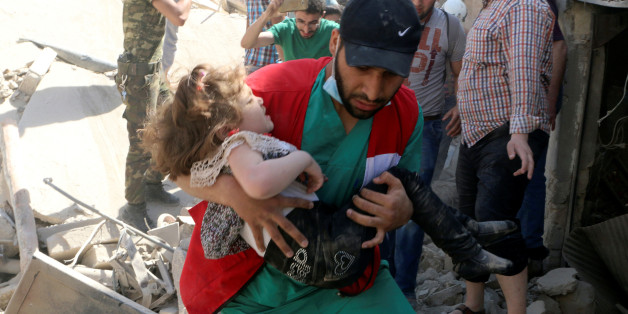 A civil defence member carries a child that survived from under the rubble at a site hit by airstrikes in the rebel held area of Old Aleppo, Syria, April 28, 2016. REUTERS/Abdalrhman Ismail     TPX IMAGES OF THE DAY