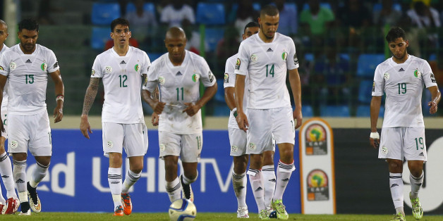 Algeria players react after a goal by Ivory Coast's Wilfried Bony (unseen) during their quarter-final soccer match of the 2015 African Cup of Nations in Malabo February 1, 2015. REUTERS/Amr Abdallah Dalsh (EQUATORIAL GUINEA - Tags: SPORT SOCCER)