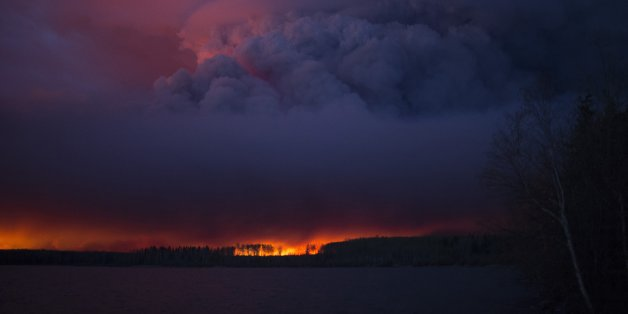 A massive wildfire, which caused a mandatory evacuation, rages south of Fort McMurray near Anzac, Alberta, Canada May 4, 2016. .  Chris Schwarz/Government of Alberta/Handout via REUTERS  ATTENTION EDITORS - THIS IMAGE WAS PROVIDED BY A THIRD PARTY. EDITORIAL USE ONLY. FOR EDITORIAL USE ONLY. NOT FOR SALE FOR MARKETING OR ADVERTISING CAMPAIGNS. THIS IMAGE HAS BEEN SUPPLIED BY A THIRD PARTY. IT IS DISTRIBUTED, EXACTLY AS RECEIVED BY REUTERS, AS A SERVICE TO CLIENTS