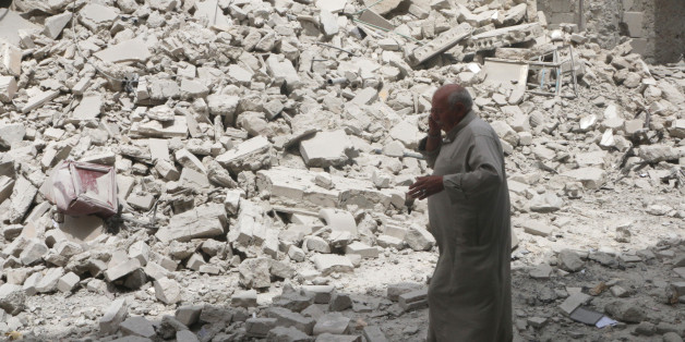 A man walks past the rubble of damaged buildings after an airstrike in the rebel held area of Aleppo's Baedeen district, Syria, May 3, 2016. REUTERS/Abdalrhman Ismail