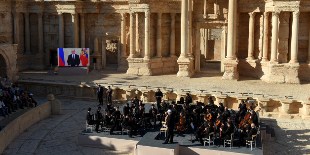 Russian conductor Valery Gergiev leads a concert in the amphitheatre of the ancient city of Palmyra on May 5, 2016. / AFP / VASILY MAXIMOV        (Photo credit should read VASILY MAXIMOV/AFP/Getty Images)