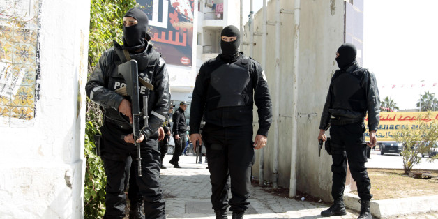 """Police officers stand outside the parliament in Tunis March 18, 2015. Gunmen in military uniforms stormed Tunisia's Bardo National Museum, killing 17 foreign tourists and two Tunisians on Wednesday in one of the worst militant attacks in a country that has largely escaped the region's """"Arab Spring"""" turmoil. REUTERS/ Zoubeir Souissi (TUNISIA - Tags: CRIME LAW CIVIL UNREST POLITICS TPX IMAGES OF THE DAY)"""