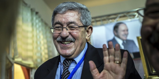 Ahmed Ouyahia, newly elected leader of Rally for National Democracy (RND), waves to his party members in Zeralda, west of Algiers, Algeria June 10, 2015. Algerian President Abdelaziz Bouteflika's cabinet director and loyal backer Ahmed Ouyahia was elected as the new leader of one of the two ruling parties on Wednesday, confirming his status of potential presidential successor. REUTERS/Zohra Bensemra