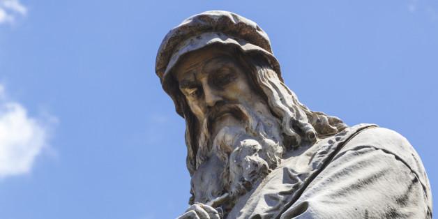 Milan, Milan Province, Lombardy, Italy.  Statue in Piazza della Scala of artist Leonardo da Vinci, 1452-1519, by Pietro Magni, 1817-1877.