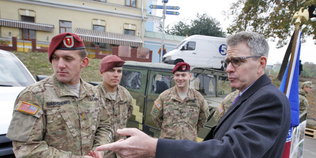 KIEV, UKRAINE - 2015/10/14: US Ambassador to Ukraine Geoffrey Pyatt (R) speaks with the American servicemen during the opening of the exhibition of military equipment called ''The strength of the unconquered '',on the occasion of the Defender of the Fatherland Day,on the Mikhailovskaya square. (Photo by Vasyl Shevchenko/Pacific Press/LightRocket via Getty Images)