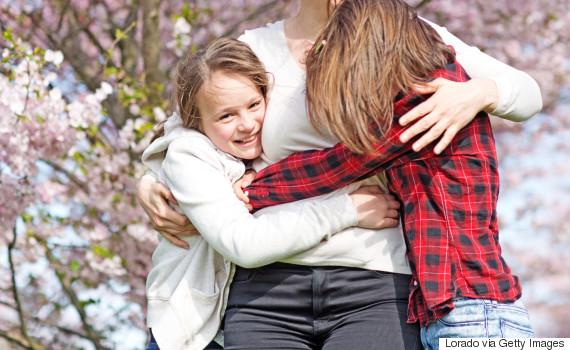 kids hugging mom cherry tree