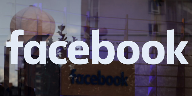 The logo of Facebook is pictured on a window at new Facebook Innovation Hub during a media tour in Berlin, Germany, February 24, 2016.  REUTERS/Fabrizio Bensch/File Photo