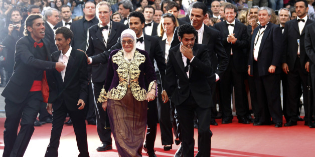 Director Rachid Bouchareb (2nd L) arrives on the red carpet with cast members Chafia Boudraa (C), Sami Bouajila (3rd R), Jamel Debbouze (2nd R) and Roschdy Zem for the screening of the film Hors La Loi (Outside the Law) in competition at the 63rd Cannes Film Festival May 21, 2010. Nineteen films are competing for the prestigious Palme d'Or which will be awarded on May 23.       REUTERS/Yves Herman (FRANCE - Tags: ENTERTAINMENT)