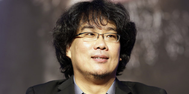 """Director Bong Joon-Ho listens to reporters' question during press conference of his new film """"Snowpiercer"""" in Seoul, South Korea, Monday, July 29, 2013. The movie is to be released in South Korea on Aug. 1. (AP Photo/Lee Jin-man)"""
