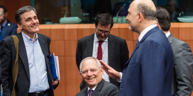 Germany's Finance Minister Wolfgang Schauble center, talks with EU Commissioner for Economic and Financial Affairs, Taxation and Customs Pierre Moscovici, right, and Greece's Finance Minister Euclid Tsakalotos during the Eurogroup finance ministers meeting at the EU Council building in Brussels on Thursday, Feb. 11, 2016. (AP Photo/Geert Vanden Wijngaert)