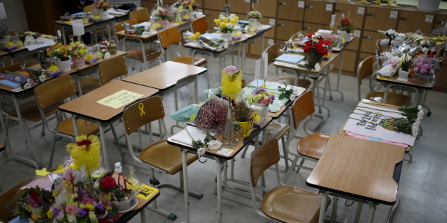 Desks used by victims who were onboard sunken ferry Sewol are seen at an empty classroom, which was preserved since the disaster, at Danwon high school during the second anniversary of the disaster in Ansan, South Korea, April 16, 2016.  REUTERS/Kim Hong-Ji