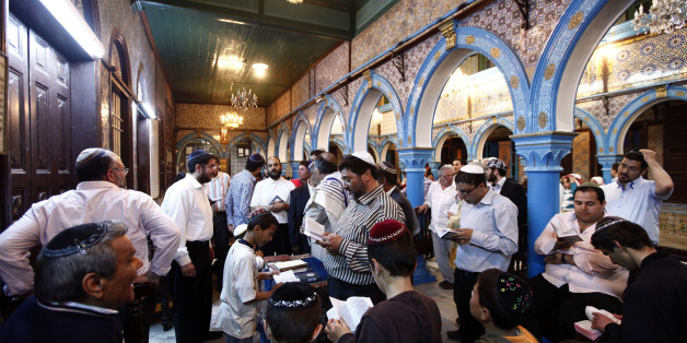 Jewish men pray inside the blue-tiled El Ghriba synagogue on the Tunisian island of Djerba following a wedding ceremony May 10, 2012. Security concerns and threats from some Salafi Islamists kept thousands of Jewish pilgrims away from an annual celebration on the Tunisian island of Djerba this week, with no more than 500 pilgrims attending - an event that used to attract thousands of visitors. Numbers have plummeted since the overthrow of authoritarian secular leader Zine al-Abidine Ben Ali in a