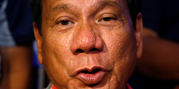 """Presidential candidate Rodrigo """"Digong"""" Duterte talks to reporters in Davao city in southern Philippines, May 9, 2016. REUTERS/Erik De Castro"""