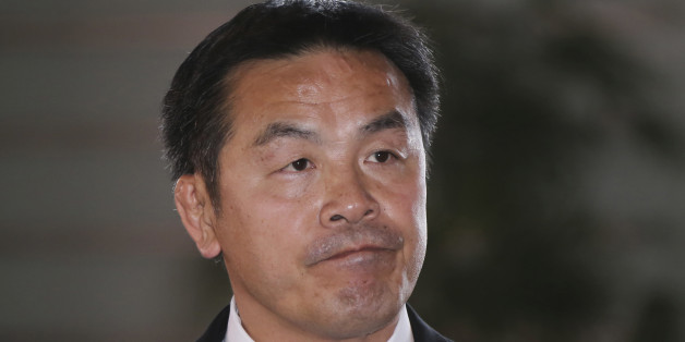 Japan's newly-named Minister of Education, Culture, Sports, Science and Technology Hiroshi Hase arrives at the prime minister's official residence before attending the attestation ceremony at the Imperial Palace, in Tokyo, Wednesday, Oct. 7, 2015. (AP Photo/Koji Sasahara)