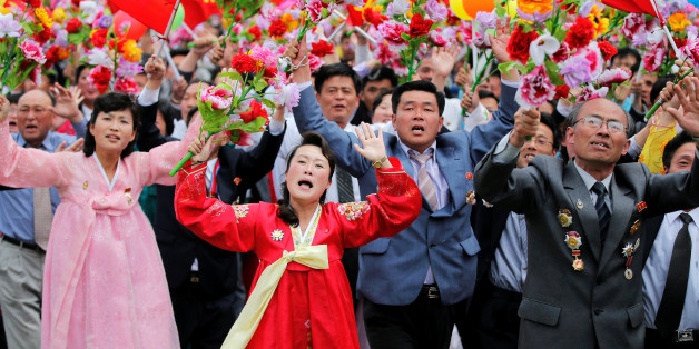 People react as they see North Korean leader Kim Jong Un during a mass rally and parade in the capital's main ceremonial square, a day after the ruling party wrapped up its first congress in 36 years by elevating him to party chairman, in Pyongyang, North Korea, May 10, 2016.  REUTERS/Damir Sagolj     TPX IMAGES OF THE DAY