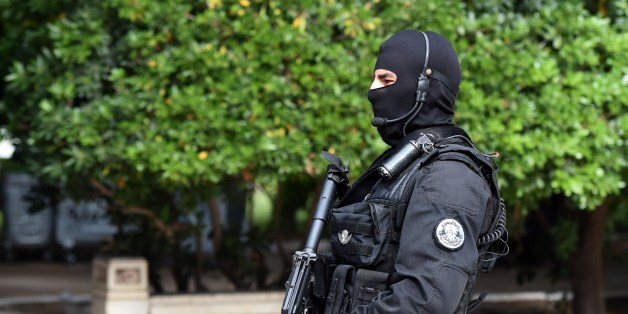 A member of Tunisian special forces stands guard outside the Constituent assembly during the visit of Moroccan King during his visit on May 31, 2014 in Tunis.  AFP PHOTO / FETHI BELAID        (Photo credit should read FETHI BELAID/AFP/Getty Images)