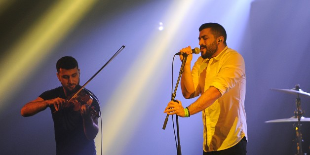 Hamed Sinno (R) and Haig Papazian of Lebanese alternative rock band Mashrou' Leila perform on stage at the 39th 'Le Printemps de Bourges' rock and pop music festival in Bourges, central France, on April 26, 2015. AFP PHOTO / GUILLAUME SOUVANT        (Photo credit should read GUILLAUME SOUVANT/AFP/Getty Images)
