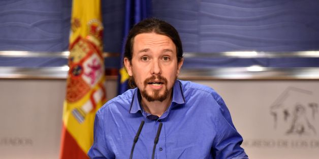 Leader of left wing party Podemos Pablo Iglesias gestures during a press conference at the Spanish parliament in Madrid on April 26, 2016.