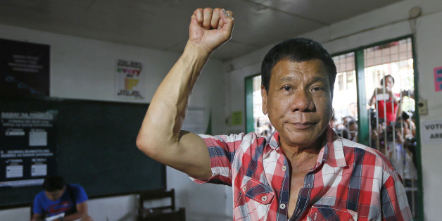 Front-running presidential candidate Mayor Rodrigo Duterte clenches his fist prior to voting in a polling precinct at Daniel R. Aguinaldo National High School at Matina district, his hometown in Davao city in southern Philippines Monday, May 9, 2016. Duterte was the last to vote among five presidential hopefuls. (AP Photo/Bullit Marquez)