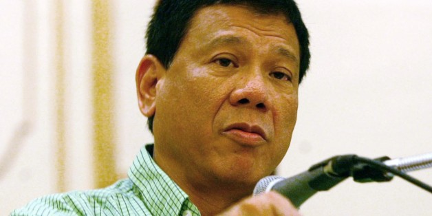 Mayor Rodrigo Duterte of the city of Davao, gestures as he addresses the peace and order council meeting he convened Thursday March 6, 2003 in the wake of the powerful bombing outside the Davao city International Airport in southern Philippines which killed 21 people. Duterte's tough anti-crime methods turned his sprawling Davao port city from a chaotic murder capital in the 1980s to a relatively tranquil and progressive niche in the Philippines' poor and violent south but last week's bombing sh