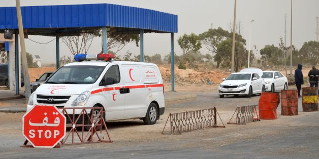 Tunisian security forces check vehicles near the Tunisian customs post at the Ras Jedir border crossing with Libya, south of the town of Ben Guerdane, on March 22, 2016 after it was reopened after a two-week closure in response to a deadly jihadist attack on a town near the frontier.  Both the Ras Jedir crossing on the Mediterranean coast and the Dehiba crossing in the mountainous desert interior reopened at 0600 GMT, ministry spokesman Yasser Mesbah said.Tunisia closed the two crossings on March 7 when dozens of heavily armed jihadists who had slipped across the border from Libya launched coordinated attacks on police and army posts in the town of Ben Guerdane, north of Ras Jedir.     / AFP / FATHI NASRI        (Photo credit should read FATHI NASRI/AFP/Getty Images)