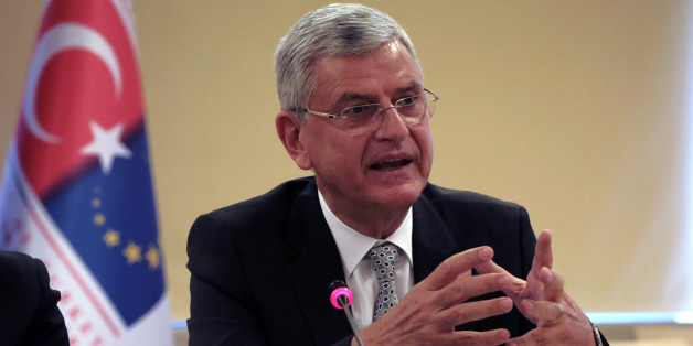 """Turkey's EU Affairs Minister Volkan Bozkir speaks during a news conference with Foreign Minister Mevlut Cavusoglu in Ankara, Turkey, Wednesday, May 4, 2016. Turkey has hailed the European Union executive Commission's recommendation to grant Turkish citizens the right to travel to Europe without visas as """"a new page"""" in relations between Turkey and the EU. Cavusoglu said Wednesday's announcement brings Turkish citizens closer than ever to visa-free travel to Europe.(AP Photo/Burhan Ozbilici)"""
