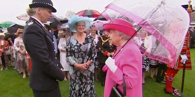 Britain's Queen Elizabeth speaks to Commander Lucy D'Orsi during a garden party at Buckingham Palace in London, in this still image taken from video, Britain, May 10, 2016.  REUTERS/ROYAL POOL via Reuters TV.  ATTENTION EDITORS -  UNITED KINGDOM OUT. NO COMMERCIAL OR EDITORIAL SALES IN UNITED KINGDOM.  TPX IMAGES OF THE DAY