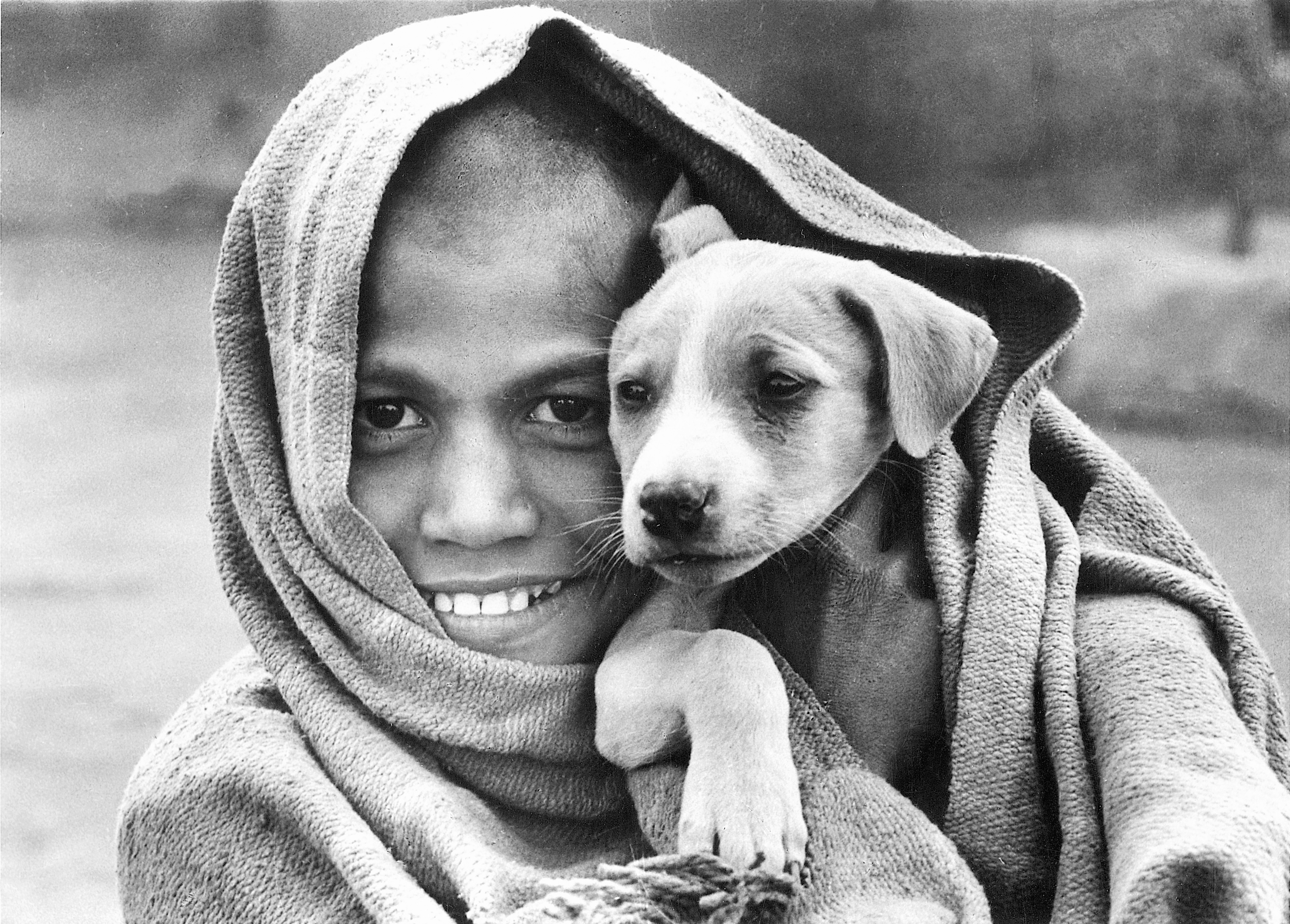 indian kids with puppies