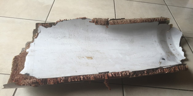 A piece of debris found by a South African family off the Mozambique coast in December 2015, which authorities will examine to see if it is from missing Malaysia Airlines flight MH370, is pictured in this handout photo released to Reuters March 11, 2016. REUTERS/Candace Lotter/Handout via Reuters      ATTENTION EDITORS - THIS PICTURE WAS PROVIDED BY A THIRD PARTY. REUTERS IS UNABLE TO INDEPENDENTLY VERIFY THE AUTHENTICITY, CONTENT, LOCATION OR DATE OF THIS IMAGE. FOR EDITORIAL USE ONLY. NOT FOR SALE FOR MARKETING OR ADVERTISING CAMPAIGNS. NO RESALES. NO ARCHIVE. THIS PICTURE IS DISTRIBUTED EXACTLY AS RECEIVED BY REUTERS, AS A SERVICE TO CLIENTS. MUST ON SCREEN COURTESY CANDACE LOTTER. MANDATORY CREDIT
