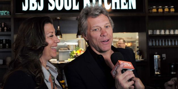 US signer Jon Bon Jovi and his wife Dorothea speak to the media after opening the BEAT (Bringing Everyone All Together) center in Toms River, New Jersey, on May 10, 2016.