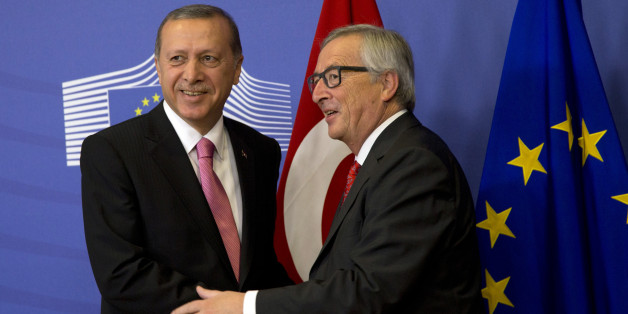 Turkish President Recep Tayyip Erdogan, left, is greeted by European Commission President Jean-Claude Juncker prior to a meeting at EU headquarters in Brussels on Monday, Oct. 5, 2015. Erdogan is on a two-day visit to meet Belgian and EU officials. (AP Photo/Virginia Mayo)