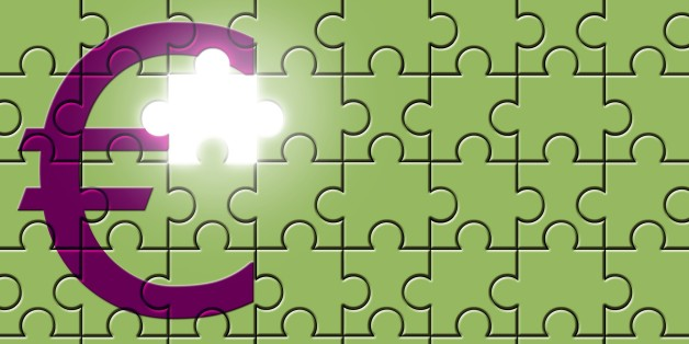 Euro sign on a puzzle with missing piece