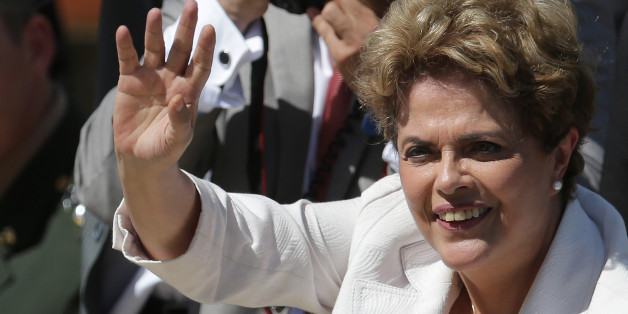 "Brazilian President Dilma Rousseff greets supporters as she leaves Planalto president palace in Brasilia, Brazil, Thursday, May 12, 2016.  Hours after the Senate voted to suspend her, Rousseff blasted the impeachment process against her as ""fraudulent"" and promised to fight what she characterized as an injustice more painful than the torture she endured under a past military dictatorship. (AP Photo/Eraldo Peres)"