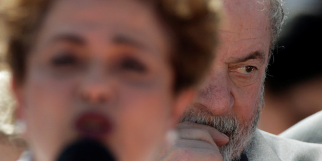 Brazil's former President Luiz Inacio Lula da Silva (R) listens as suspended President Dilma Rousseff addresses supporters, after the Brazilian Senate voted to impeach her for breaking budget laws, at Planalto Palace in Brasilia, Brazil, May 12, 2016.   REUTERS/Ueslei Marcelino        TPX IMAGES OF THE DAY
