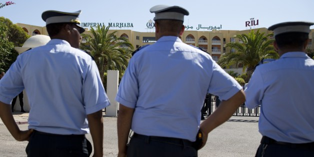 Tunisian policemen stand guard at the Riu Imperial Marhaba Hotel in Port el Kantaoui, on the outskirts of Sousse south of the capital Tunis, on June 29, 2015 where a deadly attack took place the previous week. Tunisia said it had made its first arrests after a beach massacre that killed 38 people, as European officials paid tribute to victims of the country's worst jihadist attack. AFP PHOTO / KENZO TRIBOUILLARD        (Photo credit should read KENZO TRIBOUILLARD/AFP/Getty Images)