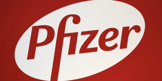 The Pfizer logo is displayed at world headquarters, Monday, Nov. 23, 2015 in New York. Pfizer and Allergan will join in a $160 billion deal to create the world's largest drugmaker. (AP Photo/Mark Lennihan)