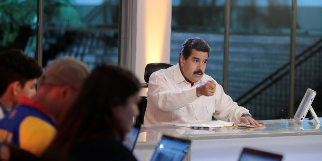 """Venezuela's President Nicolas Maduro (C) speaks during his weekly broadcast """"En contacto con Maduro"""" (In contact with Maduro) at the Miraflores Palace in Caracas, Venezuela, May 10, 2016, in this handout photo provided by Miraflores Palace. Miraflores Palace/Handout via REUTERS ATTENTION EDITORS - THIS PICTURE WAS PROVIDED BY A THIRD PARTY. EDITORIAL USE ONLY."""
